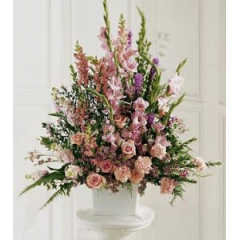 A Beautiful Arrangement Of All Pink Glads, Carnations, Roses And Snapdraggons Accented With Purple Liatris And Wax Flower. Touching