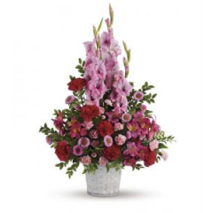 A Smart Combination of Gladiolus, Standard And Mini Carnations And Pink Asters designed in a white basket.