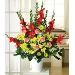 A Respectful Combination Of Orange Gladiolus/Yellow Daisies, Alstroemeria , Peach Carnations With White Monte Casino Asters.