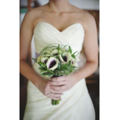A Very Unique Bouquet Of Calla Lilies Encased With Lilly Grass.
