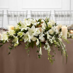 Pure White Speaks To The True Nature Of Wedding Elegance. Orchids, Lilies And Roses Are Accented With Greens For The Guests Tables.