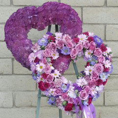 A uniquely designed double heart for your special loved one. Designed with blue and lavender carnations & roses