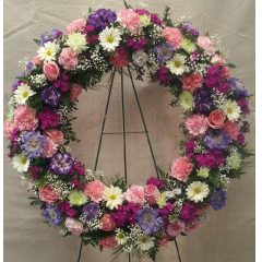 "A beautiful 24"" wreath to show your condolences.  The flowers and colors on this wreath will vary depending on whether it is for a man or a woman. More traditional feminine tones will be chosen for a lady unless you request a different color scheme. Traditional masculine tones will be chosen for a man unless a different color scheme is requested. Varieties of flowers will vary with the season to give you the best show and value for the design.   Colors Will Vary."
