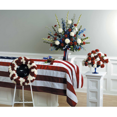 SF25-13 PEDESTAL ARRANGEMENT WITH WHITE GLADS, WHITE MUMS, RED CARNATIONS, BLUE DELPHINIUM 195.95  SF25-11-RED AND WHITE PATRIOTIC WREATH-$350.95 SF25-14-CONTAINER NOT AVAILABLE-CALL FOR PRICING  SF25-12 WITH 6 ROSES: 39.95 SF25-`2 WITH 12 ROSES: 59.95