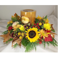 "Celebrate the holiday with a festive Thanksgiving centerpiece featuring a fabulous Rosy Ring botanical scented pillar candle. This giant candle is surrounded by a spectacular display of the freshest fall flowers. Rosy Ring Candles have a 200 to 300 hour burn life, depending on the size of the candle.  ""Candle Scents May Vary"" but all scents remind you of the holiday season and the wonderful memories that have been made!"