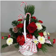 Traditional one-sided Basket with red roses, white cushions, Christmas ornaments, pine cones & accented with red & white candy canes.  approx size 18x18