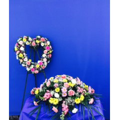 SPRING FLOWERS DESIGNED WITH MATCHING HEART & CASKET SPRAY   **COLORS & FLOWERS WILL VARY**