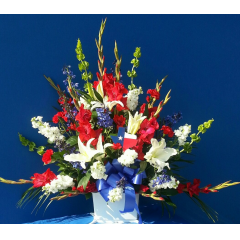 A BEAUTIFUL RED, WHITE, BLUE SYMPATHY BASKET ARRANGEMENT.  PERSONALIZE WITH YOUR STATES LOGO