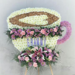 FOR THOSE WHO LOVE LATTES AND LOVE LIFE THIS VERY PERSONAL DESIGN SPEAKS TO THE MEMORY OF A SPECIAL LOVED ONE. LET LOG CABIN FLORIST DESIGN A ONE OF A KIND FINAL TRIBUTE TO CAPTURE THE PERSONALITY OF YOUR MOST PRECIOUS LOVED ONE.