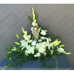 REMEMBERING THE ANGEL IN YOUR LIFE. THIS DESIGN FEATURES ANGEL STATUARY SURROUNDED BY BEAUTIFUL FLOWERS.