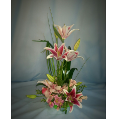 A stylish arrangement graces with orchids and lilys. A real show stopper!