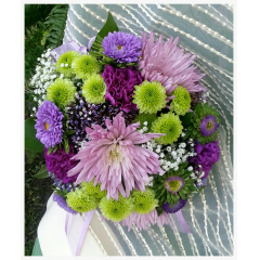 "A FRESH SASSY BOUQUET IN MIXED LAVENDER, PURPLE AND CITRUS LIME TONES. THIS BOUQUET IS BEAUTIFUL AS PICTURED OR WE CAN ADD PINK OR SPRING TONES FOR AN ENTIRELY DIFFERENT FEEL. LET US CUSTOMIZE YOUR BOUQUET TO BE A ""ONE OF A KIND."""