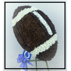 A large floral football that will be personalized with your loved ones favorite team colors and script. Price is for basic football as pictured. Additional custom script prices vary.