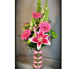 a BEAUTIFUL BOUQUET FILLED WITH GERBERA DAISIES, ORIENTAL LILIES TIED OFF WITH A CREATIVE BALLET WRAP...SURE TO WOW THE LUCK RECIPIENT!