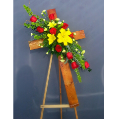 "A RUSTIC 36"" TALL WOODEN CROSS DESIGNED WITH A CLUSTER OF YOUR FAVORITE MIXED FLOWERS. PLEASE SPECIFY IF YOU WOULD LIKE DIFFERENT COLORS THAN PICTURED."