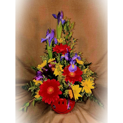 A MODERN SPIN ON THE CLASSIC SMILEY FACE ARRANGEMENT. THIS ARRANGEMENT WILL BRING A SMILE TO ANYONE'S FACE!