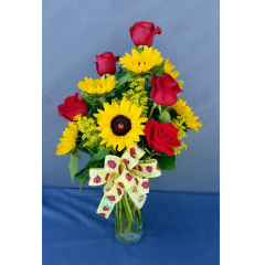 Welcome spring with the fun arrangement of roses and sunflowers embellished with lady bugs and a fun bow. This arrangement will brighten anyone's day!