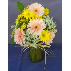 A FUN DESIGN WITH COUNTRY FLAIR. WE CAN ALSO MAKE THIS WITH MIXED GERBERAS. PLEASE ASK FOR COLOR AVAILABILITY.