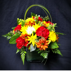 This is a basic contemporary centerpiece we offer in any color pallet you choose. Fresh flowers elevate any occasion and make it just a little more special. Let Log Cabin Florist make your special event one to remember! Centerpiece pictured is 39.95