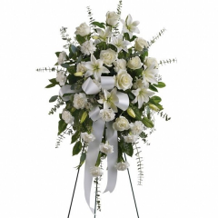 A tasteful easel spray that conveys your love and condolences to the family in their time of grief.