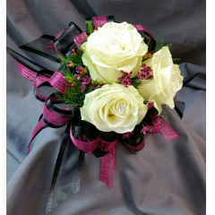 This Elegant Clutch Bouquet is available in all colors of Roses and is an excellent choice for your Winter Formal or Valentine's Day Romantic Evening!.