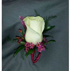 SIMPLE, ELEGANT AND CLASSIC. A SINGLE ROSE WITH COORDINATING FILLER FLOWER AND GREENS