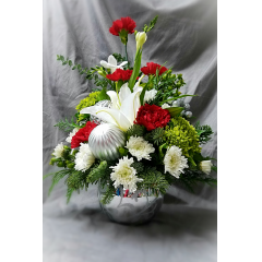 This is an upscale holiday arrangement that makes the perfect corporate gift for a special client or holiday party. All the winter colors of the holiday and with the fresh scent of pine!