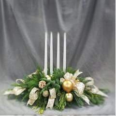 """This is a classic centerpiece design that is approximately 36"""" long in fresh Christmas Greens, balls, and cones that features 4 tall taper candles. We would be happy to adjust the color scheme to suite your decor."""