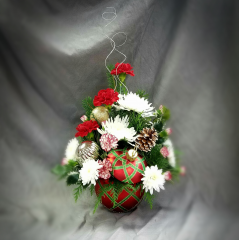 Fun and festive, this bright fresh holiday bouquet will brighten anyone's home or office!