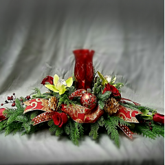 "This is a stunning 36"" long centerpiece designed in festive holiday colors. It includes roses, orchids and premium decor. This is a gift that will be remembered for seasons to come. A real show stopper!!"
