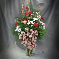 Log Cabin Florists Winter Holiday Bouquet is a tall arrangement that would be beautiful on a office counter or setting on a bar or dining table in a home!  It is a beautiful combination of fresh winter greens and flowers. A nice gift for someone who no longer decorates a tree!