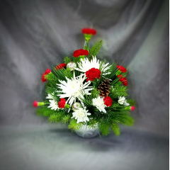 Fun and festive, this bright fresh holiday bouquet will add a special touch to anyone's home or office! Designed in a silver ceramic ornament, this container is perfect as a candy dish for your holiday table for years to come.