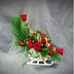 This a beautiful ceramic sleigh, perfect for a candy dish  for many holidays to come. Traditional flowers and greens that are a perfect gift for that difficult to buy for individual.