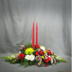 """Share the warmth of the holiday season with this beautiful centerpiece in traditional Christmas colors. Approximately 28"""" long. Candles are 141/2"""" tall."""