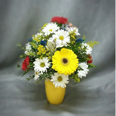 "It feels like spring with this sunny yellow daisy ringed vase full all the best flowers for a long lasting bouquet to chase away the winter blues!. Approximately 16""tall over all."