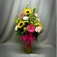 "All the bright colors of spring will tell her she is your sunshine and her smile will brighten your day too! This is a perfect bouquet for someone who loves all types of flowers. Add a rose for just a few dollars more! This arrangement is approximately 24"" tall."