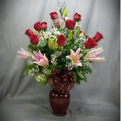 "A beautiful bouquet of one dozen imported roses embellished  with 5 stems of Oriental lilies.   Voted ""Best of Bakersfield"" for 23 years running!"