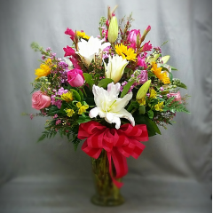 The Ultimate Bouquet is amazingly beautiful!  Standing approximately 3' tall, this fresh, colorful bouquet of Fresh Cut Flowers will show your true Love that only the BEST will do!!