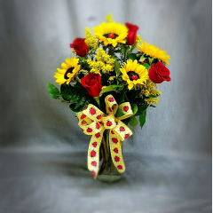 "This is a classic fun bouquet that is well received for any occasion. It stands approximately 24"" tall and includes sunflowers and red roses. We are happy to substitute a different color rose upon request.."