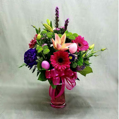 """CELEBRATE SPRING WITH THIS  BEAUTIFUL MIX OF BRIGHT SPRING FLOWERS AND EASTER DECOR. YES, SOME BUNNY LOVES YOU! ARRANGEMENT IS APPROXIMATELY 22"""" TALL AND 14"""" WIDE."""