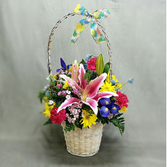 A LARGE EASTER BASKET IS FILLED WITH THE COLORS AND FLOWERS OF THE SEASON. THIS CHEERFUL ARRANGEMENT IS PERFECT FOR YOUR EASTER TABLE OR TO  SEND TO SOMEONE SPECIAL TO BRIGHTEN THEIR DAY!