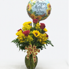 """Show Mom your Love and Appreciation this Mother's Day with our, """"Ladies in the Sun"""" bouquet!  This amazing arrangement is filled with Red Roses, Yellow Sunflowers and includes a, """"Happy Mothers Day"""" Mylar balloon. This impressive arrangement is approximately 36"""" tall. **Height includes balloon"""