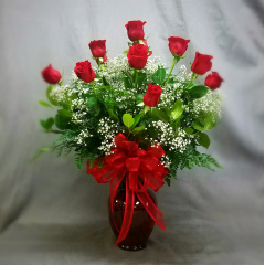 Celebrate any Milestone with the time honored tradition of Long Stem Red Roses!  This gorgeous arrangement is filled with a dozen Lush Red Roses, accented with filler flowers and greenery.