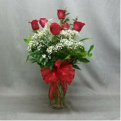 ROSES ARE ALWAYS PERFECT FOR A CELEBRATION! SIX LONG STEM RED ROSES ARRANGED IN A VASE. ADD BALLOONS AND YOU ARE SET FOR THE GRADUATION!