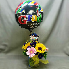 Bright, fun and festive, this is the perfect bouquet and balloon to say Congratulations, We are so proud of you! A great value too!