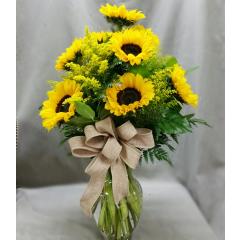 Beautiful Sunflower arrangement in a vase with solidago and country raffia bow **CONTAINER MAY VARY**