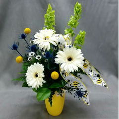 "Brighten someone""s day with the Bee Happy Bouquet! a mix of summer flowers that is approximately 18"" tall. This is the perfect gift guaranteed to bring a smile."