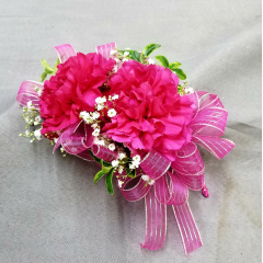This traditional favorite is a nice average size corsage and is appropriate for any occasion. Available in many colors. Call for color availability. Please order early as we hand make each corsage for your special occasion.