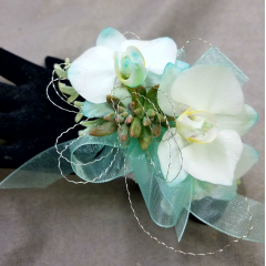 Allow us to air brush miniature phal orchids to complement your attire! Rhinestone wristlet is a finishing touch!