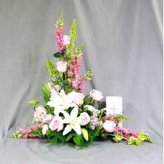 "This is an elegant stylized table top arrangement Approximately 30"" tall and 30"" wide. It will display nicely with either and photograph or a memorial urn."